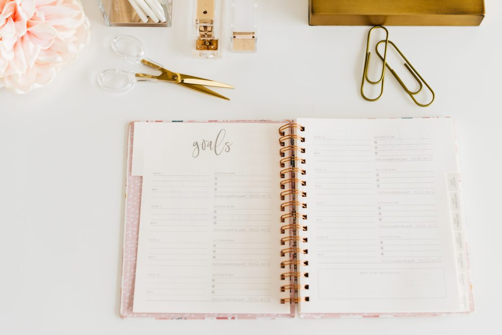 Open journal with goals heading